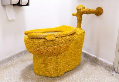 Guerrilla Artist Yarn-Bombs Guggenheim Toilet With Gold Crochet